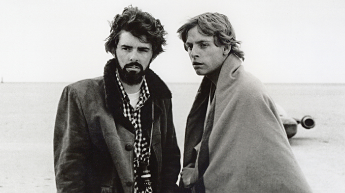 Star Wars (1977) Directed by George Lucas Shown on the set: Director George Lucas, Mark Hamill (as Luke Skywalker)